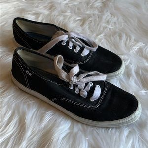Black classic Ked's sneakers with white laces